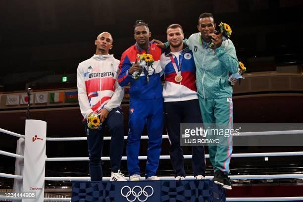 Silver medallist Britain's Benjamin Whittaker, gold medallist Cuba's Arlen Lopez, bronze medallists Russia's Imam Khataev and Azerbaijan's Loren...