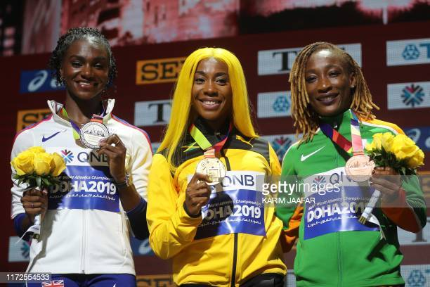Silver medallist Britain's Dina AsherSmith gold medallist Jamaica's ShellyAnn FraserPryce and bronze medallist Ivory Coast's MarieJosee Ta Lou pose...