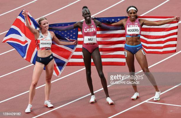 Silver medallist Britain's Keely Hodgkinson , gold medallist USA's Athing Mu and bronze medallist USA's Raevyn Rogers celebrate after the women's...
