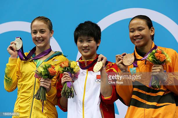 Silver medallist Brittany Broben of Australia gold medallist Ruolin Chen of China and bronze medallist Pandelela Pamg of Malaysia pose on the podium...