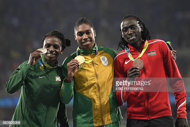 Silver medallist Burundi's Francine Niyonsaba gold medallist South Africa's Caster Semenya and bronze medallist Kenya's Margaret Nyairera Wambui pose...