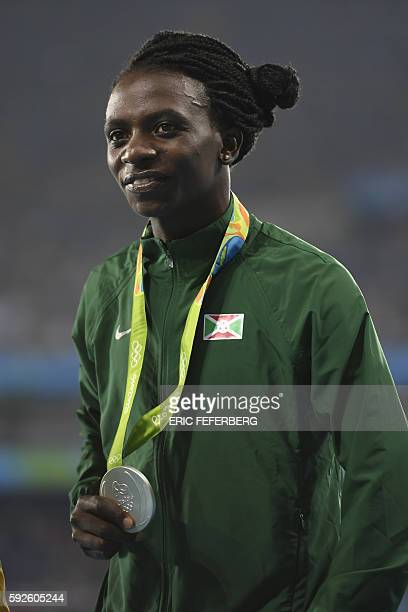 Silver medallist Burundi's Francine Niyonsaba poses on the podium for the Women's 800m Final during the athletics event at the Rio 2016 Olympic Games...