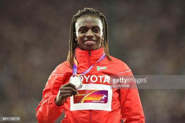 Silver medallist Burundi's Francine Niyonsaba poses on the podium during the victory ceremony for the women's 800m athletics event at the 2017 IAAF...