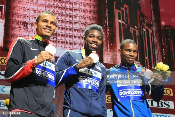 Silver medallist Canada's Andre De Grasse gold medallist USA's Noah Lyles and bronze medallist Ecuador's Alex Quinonez pose on the podium during the...