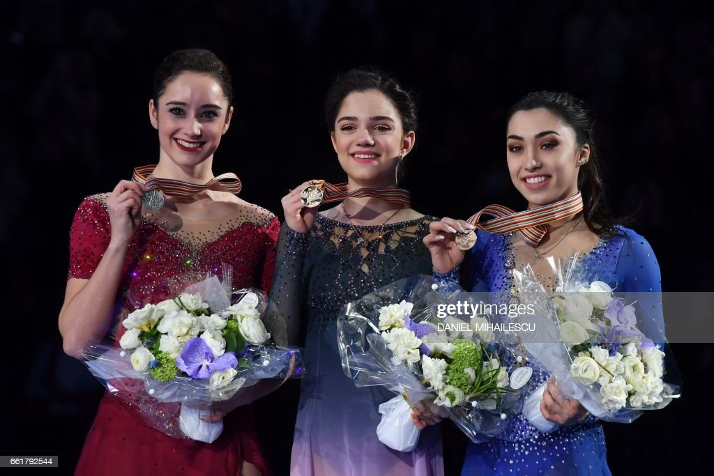 Silver medallist Canada's Kaetlyn Osmond, Gold medallist Evgenia Medvedeva of Russia and Bronze medallist Canada's Gabrielle Daleman listen to the national anthems after the woman's Free Skating event at the ISU World Figure Skating Championships in Helsinki, Finland on March 31, 2017. Evgenia Medvedeva of Russia won the Gold medal ahead of Silver medallist Canada's Kaetlyn Osmond and Bronze medallist Canada's Gabrielle Daleman. / AFP PHOTO / Daniel MIHAILESCU