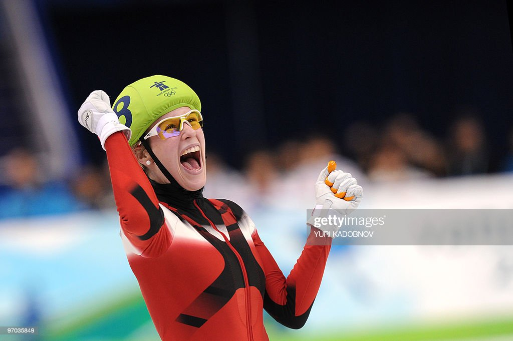 Silver medallist Canada's Marianne St-Gelais celebrates at the end of the Ladies' 3000m short-track relay final at the Pacific Coliseum in Vancouver, during the 2010 Winter Olympics on February 24, 2010.
