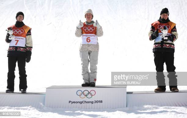 TOPSHOT Silver medallist Canada's Max Parrot gold medallist US Redmond Gerard and bronze medallist Canada's Mark McMorris celebrate during the...
