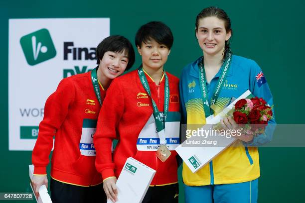Silver medallist Chang Yani of China gold medallist Shi Tingmao of China and bronze medallist Maddison Keeney of Australia poses during the medal...
