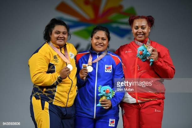 Silver medallist Charisma AmoeTarrant of Nauru gold medallist Feagaiga Stowers of Samoa and bronze medallist Emily Campbell of England pose on the...