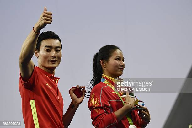 TOPSHOT Silver medallist China's He Zi reacts she receives a marriage proposal from Chinese diver Qin Kai during the podium ceremony of the Women's...