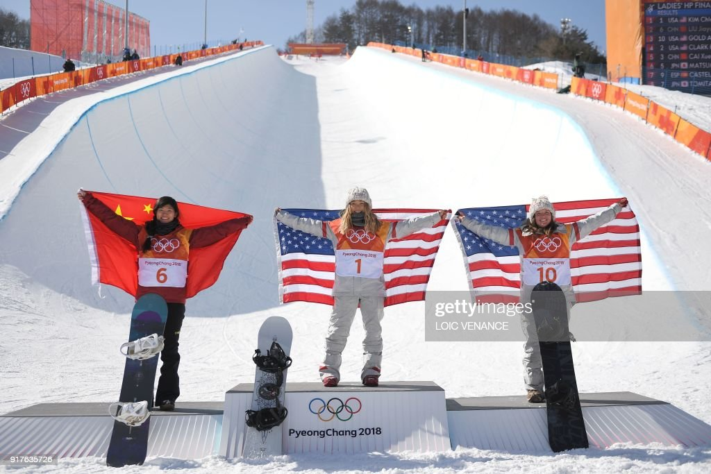 Silver medallist China's Liu Jiayu, gold medallist US Chloe Kim and bronze medallist US Arielle Gold celebrate during the victory ceremony after the women's snowboard halfpipe final event at the Phoenix Park during the Pyeongchang 2018 Winter Olympic Games on February 13, 2018 in Pyeongchang. /