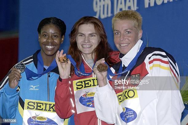 Silver medallist Christine Amertil of the Bahamas gold medallist Natalya Nazarova of Russia and bronze medallist Grit Breuer of Germany celebrate...