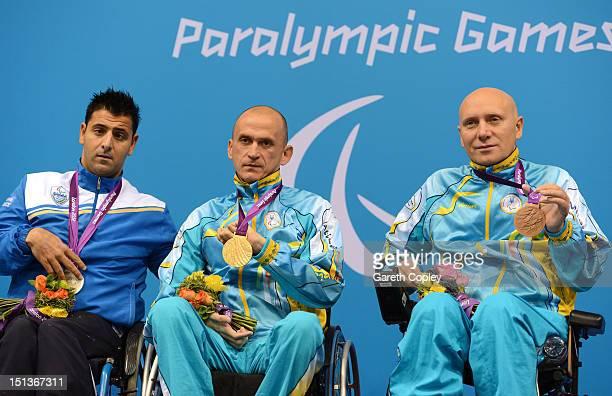 Silver medallist Christos Tampaxis of Greece gold medallist Hennadi Boiko of the Ukraine and bronze medallist Oleksandr Golovko of Ukraine pose on...