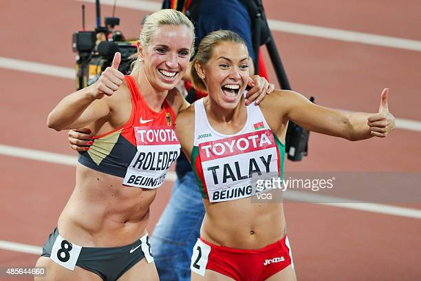 Silver medallist Cindy Roleder of Germany poses with bronze medallist Alina Talay of Belarus after the final of the women's 100 metres hurdles...