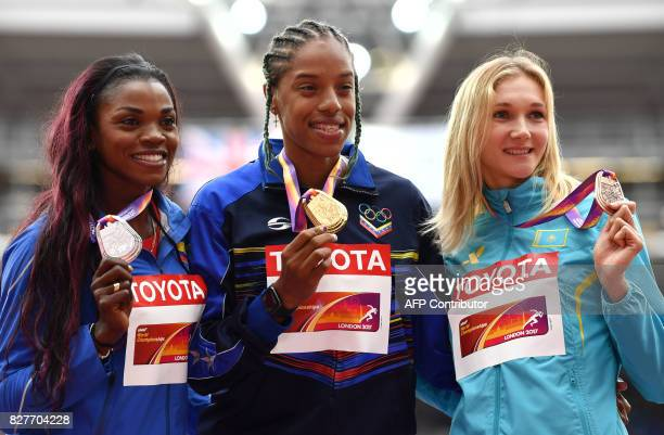 Silver medallist Colombia's Caterine Ibarguen gold medallist Venezuela's Yulimar Rojas and bronze medallist Kazakhstan's Olga Rypakova pose on the...
