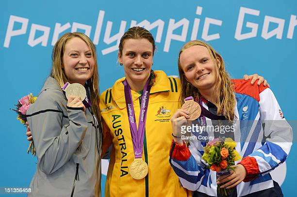 Silver medallist Cortney Jordan of the United States gold medallist Jacqueline Freney of Australia and bronze medallist Susannah Rogers of Great...