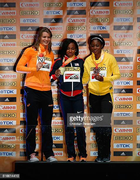 Silver medallist Dafne Schippers of the Netherlands gold medallist Barbara Pierre of the United States and bronze medallist Elaine Thompson of...