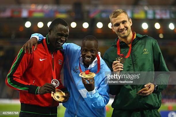 Silver medallist David Rudisha of Kenya, gold medallist Nijel Amos of Botswana and bronze medallist Andre Olivier of South Africa pose on the podium...