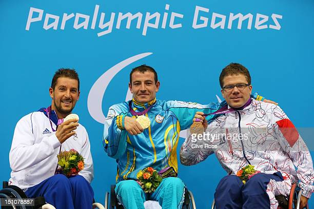 Silver medallist David Smetanine of France gold medallist Eskender Mustafaiev of Ukaraine and bronze medallist Jan Povysil of Czech Republic pose on...