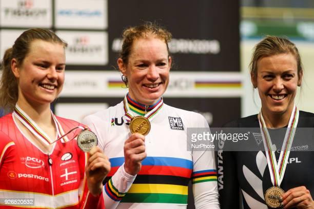 Silver medallist Demark's Amalie Dideriksen Gold medal winner Netherland's Kirsten Wild and Bronze medallist New Zealand's Rushlee Buchanan pose on...