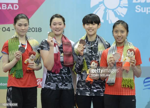 Silver medallist Deng Xuan of Hong Kong gold medallist Kim Gaeun of South Korea bronze medallists Yu Jin Sim of South Korea and Yeo Jia Min of...