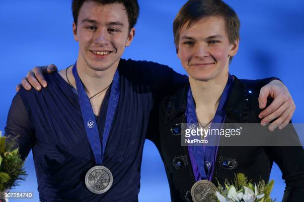Silver medallist Dmitri Aliev and bronze medallist Mikhail Kolyada poses with his medal after the men's free skating at the 2018 ISU European Figure...
