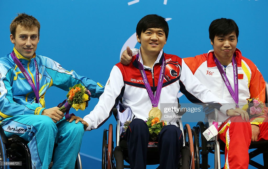 Silver medallist Dmytro Vynohradets of Ukraine, gold medallist Byeong-Eon Min of Korea and bronze medallist Jianping Du of China pose on the podium during the medal ceremony for the Men's 50m Backstroke - S3 final on day 10 of the London 2012 Paralympic Games at Aquatics Centre on September 8, 2012 in London, England.