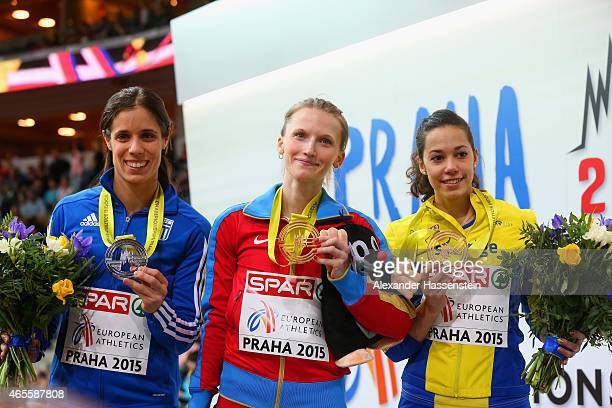 Silver medallist Ekaterini Stefanidi of Greece gold medallist Anzhelika Sidorova of Russia Bronze medallist Angelica Bengtsson of Sweden pose on the...