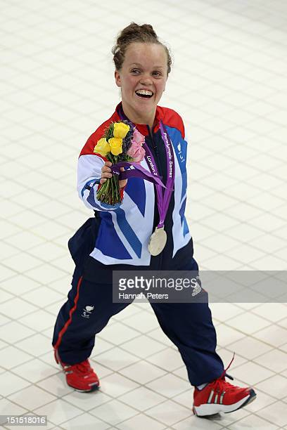 Silver medallist Eleanor Simmonds of Great Britain celebrates with her medal after competing in the Women's 100m Freestyle S6 final on day 10 of the...