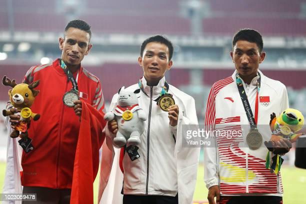 Silver Medallist Elhassan Elabbassi of Bahrain, Gold Medallist Inoue Hiroto of Japan and Duo Bujie of China poses for photo during Men's Marathon...