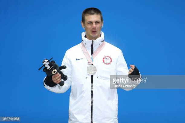 Silver medallist Evan Strong of USA celebrates during the medal ceremony for the Men's Snowboard Banked Slalom SBLL2 Final on day seven of the...