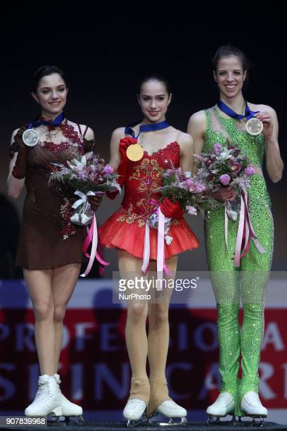 Silver medallist Evgenia Medvedeva and gold medallist Alina Zagitova of Russia bronze medallist Carolina Kostner of Italy poses during the award...