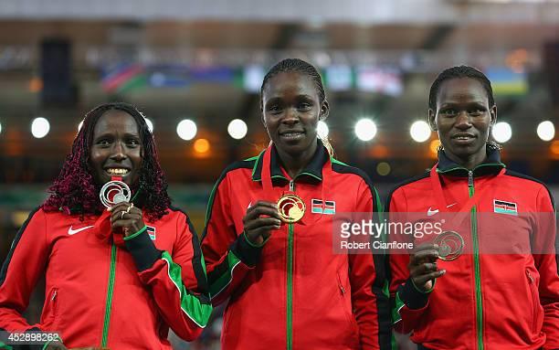 Silver medallist Florence Kiplagat of Kenya Gold medallist Joyce Chepkirui of Kenya and bronze medallist Emily Chebet of Kenya pose on the podium...