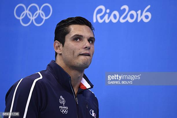 TOPSHOT Silver medallist France's Florent Manaudou poses on the podium of the Men's 50m Freestyle Final during the swimming event at the Rio 2016...