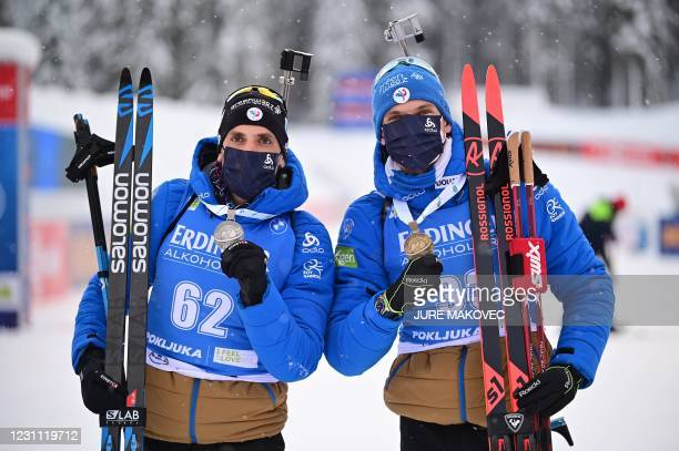 Silver medallist France's Simon Desthieux and bronze medallist France's Emilien Jacquelin pose with their medals after the Men's 10 km Sprint event...