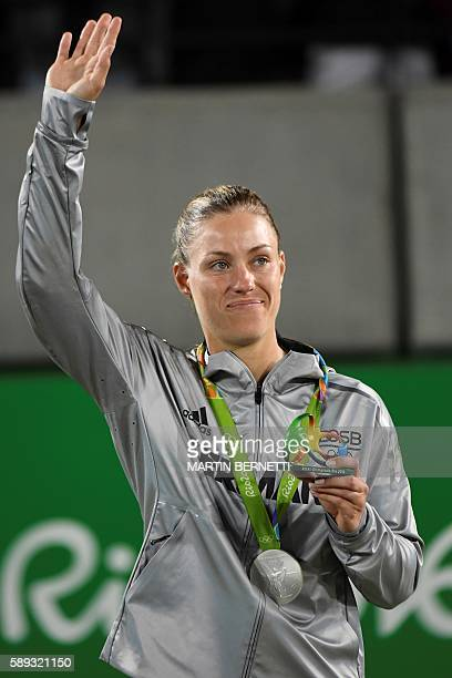 Silver medallist Germany's Angelique Kerber reacts during the podium ceremony of the women's singles tennis event at the Olympic Tennis Centre of the...