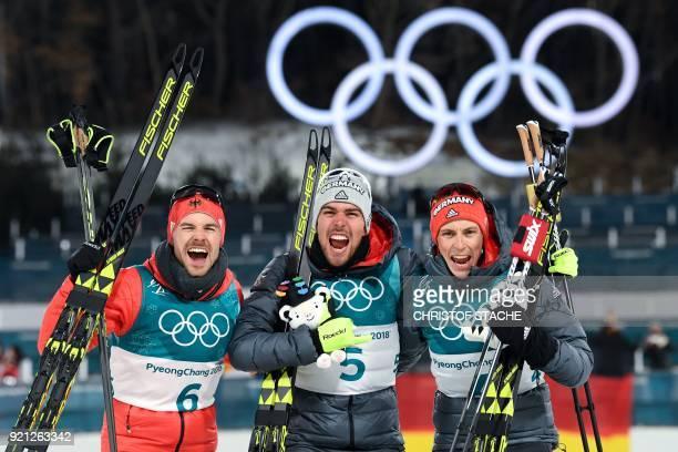 TOPSHOT Silver medallist Germany's Fabian Riessle gold medallist Germany's Johannes Rydzek and bronze medallist Germany's Eric Frenzel celebrate on...