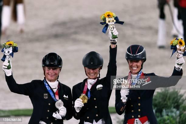 Silver medallist Germany's Isabell Werth, gold medallist Germany's Jessica von Bredow-Werndl and bronze medallist Britain's Charlotte Dujardin pose...