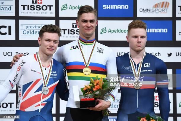 Silver medallist Great Britain's Jack Carlin gold medallist Australia's Matthew Glaetzer and bronze medallist France's Sebastien Vigier pose on the...