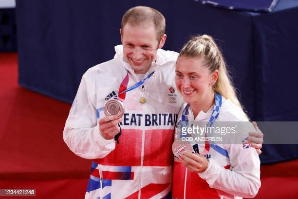 Silver medallist Great Britain's men's track cycling team sprint Jason Kenny poses with his wife silver medallist Great Britain's women's track...