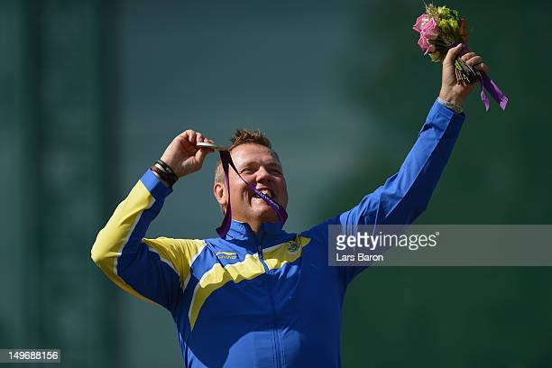 Silver medallist Hakan Dahlby of Sweden celebrates with his silver medal during the medal ceremony following the Men's Double Trap Shooting final on...