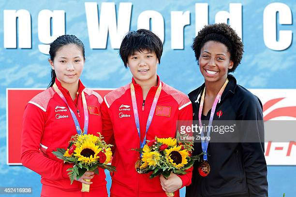 Silver medallist He Zi of China gold medallist Shi Tingmao of China and bronze medallist Jennifer Abel of Canda celebrate during the medal ceremony...