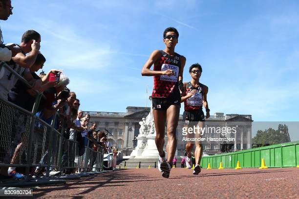 Silver medallist Hirooki Arai of Japan and bronze medallist Kai Kobayashi of Japan compete in the Men's 50km Race Walk final during day ten of the...