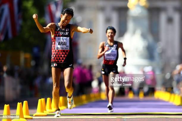 Silver medallist Hirooki Arai of Japan celebrates with bronze medallist Kai Kobayashi of Japan in the Men's 50km Race Walk final during day ten of...