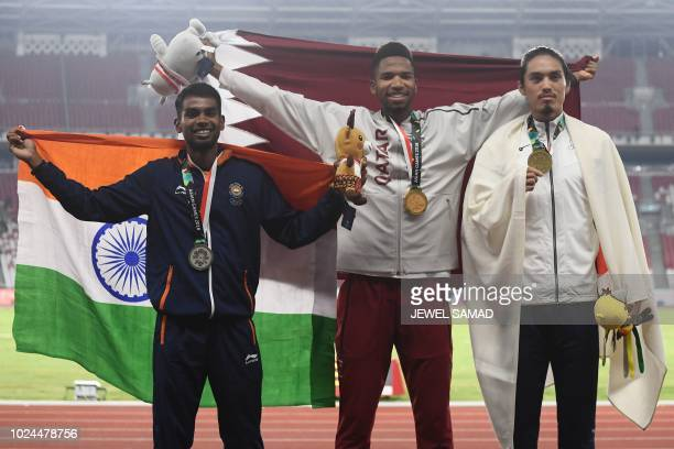 Silver medallist India's Dharun Ayyasamy gold medallist Qatar's Abderrahman Samba and bronze medallist Japan's Takatoshi Abe celebrate during the...