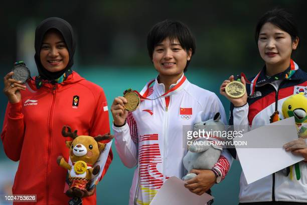 Silver medallist Indonesia's Diananda Choirunisa gold medallist China's Zhang Xinyan and bronze medallist South Korea's Kang Chaeyoung pose on the...