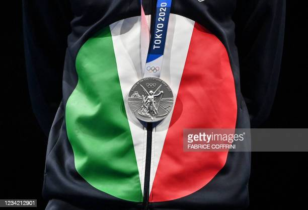 Silver medallist Italy's Daniele Garozzo celebrates on podium during the medal ceremony for the mens individual foil during the Tokyo 2020 Olympic...