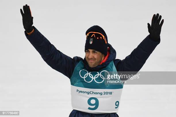 Silver medallist Italy's Federico Pellegrino celebrates on the podium during the victory ceremony in the men's crosscountry individual sprint classic...