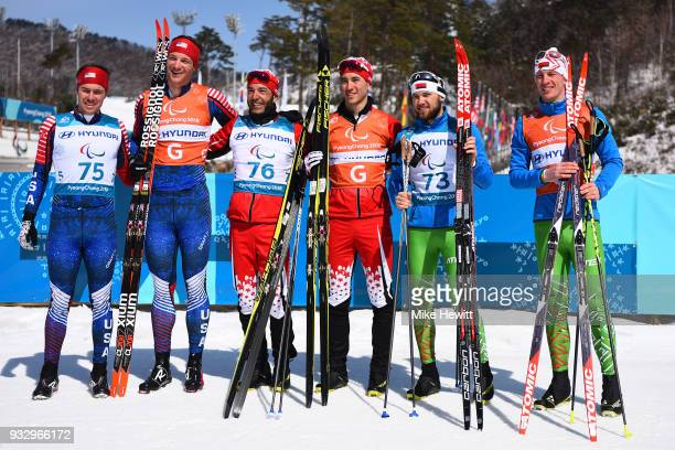 Silver medallist Jake Adicoff of USA and guide Sawyer Kesselheim Gold medallist Brian McKeever of Canada and guide Graham Nishikawa and Bronze...