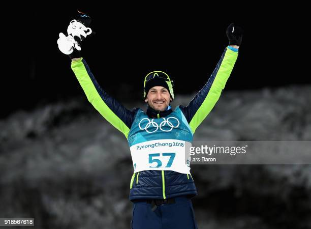 Silver medallist Jakov Fak of Slovenia celebrates during the victory ceremony for the Men's 20km Individual Biathlon at Alpensia Biathlon Centre on...